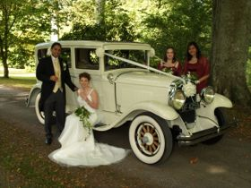 Wedding Couple in front of old timer