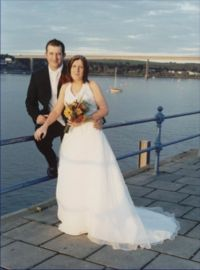 Wedding couple with Cleddau bridge on the horizon